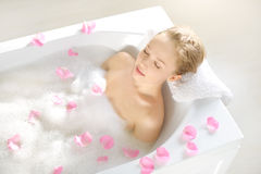 An Attractive girl relaxing in bath Royalty Free Stock Photos