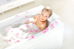 An Attractive girl relaxing in bath Stock Photos