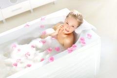 An Attractive girl relaxing in bath Stock Photos