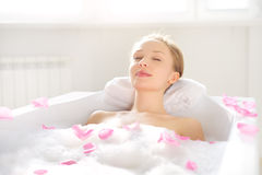 An Attractive girl relaxing in bath royalty free stock photography