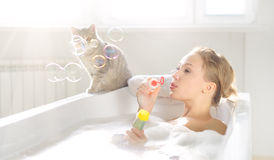 Attractive girl relaxing in bath Royalty Free Stock Photography