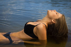 Attractive girl relaxing by the river Royalty Free Stock Photo