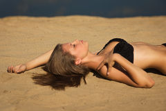 Attractive girl relaxing on a sandy beach Stock Photos
