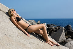 Attractive girl relaxing on a sea beach. Royalty Free Stock Photography