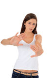 Attractive girl with repelling gesture Royalty Free Stock Photos