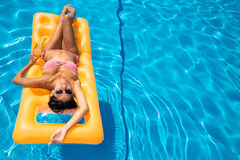 Attractive girl resting on air mattress Stock Photos