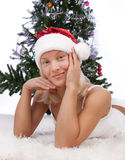 Attractive girl resting near christmas tree Stock Image