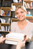 Attractive girl returning the books Stock Photography