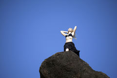 Attractive girl on rock Royalty Free Stock Photo