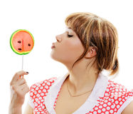 Attractive girl with a round lollipop Royalty Free Stock Photo