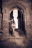 Attractive girl in ruins Stock Images