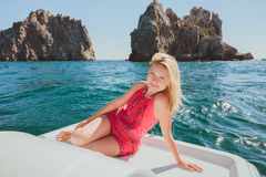Attractive girl sailing on a yacht Royalty Free Stock Photography