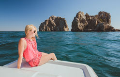 Attractive girl sailing on a yacht Royalty Free Stock Photos