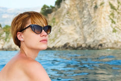 Attractive girl sailing on a yacht. summer day Stock Photo