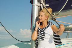 Attractive girl sailing on a yacht on summer day Royalty Free Stock Image