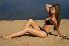 Attractive girl on a sandy beach Stock Images