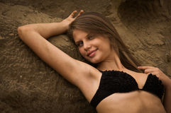 Attractive girl on a sandy beach Royalty Free Stock Photos
