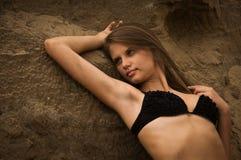 Attractive girl on a sandy beach Stock Photos