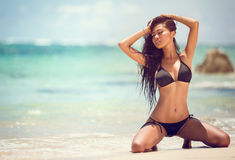 Attractive girl on sandy beach Royalty Free Stock Photos