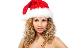 Attractive girl in santa claus hat Stock Photos