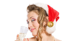 Attractive girl in Santa  hat with champagne glass Stock Image