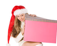 Attractive girl in Santa  hat with fancy box Stock Photos