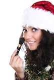 Attractive girl in santa hat with make up brush Stock Photography