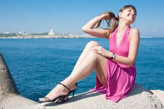 Attractive girl at the sea Stock Photography