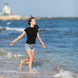 Attractive girl at the sea Royalty Free Stock Photography