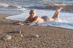 Attractive girl on seashore Stock Photos