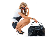 Attractive girl with sexy dress and big bag Royalty Free Stock Photography
