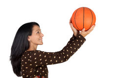 Attractive girl shooting basketball Stock Images