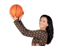 Attractive girl shooting basketball Stock Photos