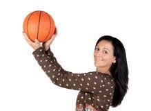 Attractive girl shooting basketball Stock Photos