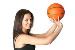 Attractive girl shooting basketball Royalty Free Stock Photos