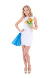 Attractive girl with shopping bags and flowers Royalty Free Stock Photography