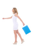 Attractive girl with shopping bags walking Royalty Free Stock Photo