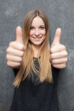 Attractive girl showing thumbs up Royalty Free Stock Images