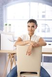 Attractive girl sitting conversely on chair Stock Photography