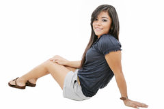 Attractive girl sitting on the floor Stock Photo