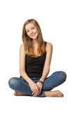 Attractive girl sitting on floor over white Royalty Free Stock Image