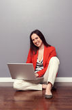 Girl sitting on the floor and working Royalty Free Stock Photography