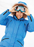 Attractive girl in ski sunglasses. Over white background Royalty Free Stock Image