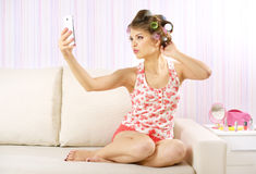 Attractive girl with a smartphone Royalty Free Stock Images