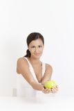 Attractive girl smiling with apple in hands Royalty Free Stock Image