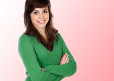 Attractive girl smiling with crossed arms. Isolated on pink background royalty free stock images