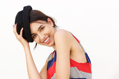 Attractive girl smiling with hat against white background Royalty Free Stock Photography