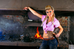 Attractive girl in the smithy Stock Photo