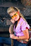Attractive girl in the smithy Stock Photography