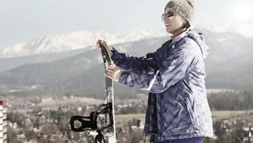 Attractive Girl with Snowboard . Ski season in the Mountains.  stock video footage